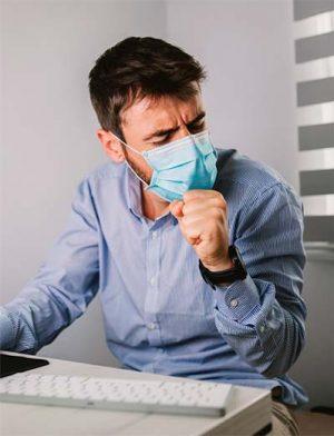 empleado-oficina-tosiendo